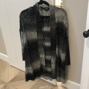 Black and grey bebe sweater with leather sides